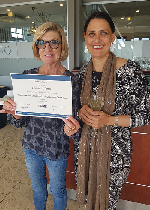 Image of a participant of the Coaching Pacific EOCC participant receiving their certificate of completion